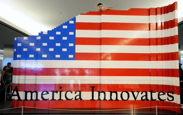 LEGO master builder Chris Steininger places a brick while building the world's largest LEGO American flag to celebrate the opening of the Innovation Wing at the National Museum of American History on Wednesday, July 1, 2015 in Washington. More than 15,000 museum visitors helped LEGO master builders create the 9.5-by-14-foot flag using more than 100,000 LEGO bricks. (Steve Ruark/AP Images for LEGO)